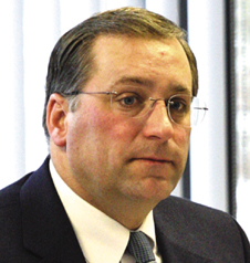 Chairman John M. Becker